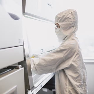 Gowned operator in the Spark Therapeutics gene therapy manufacturing facilities